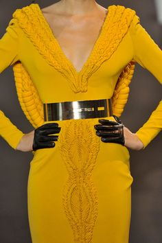Really interesting design and love the cheery yellow.  Don't quite get the finger gloves but they accent the dress.