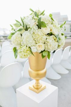 Beautiful white and gold hydrangea floral arrangement {Photo by Birds of a Feather via Project Wedding}