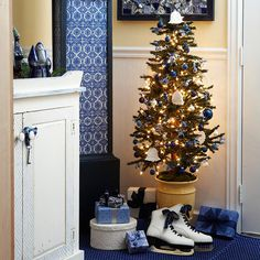 Add a Tree in a Bathroom : Don't overlook bathrooms as places to add some merry touches. Here, a small corner offers a great spot for a potted tree decorated with cream and blue ceramic bells and glass balls.