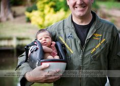I love Daddy's big smile.  I love that she's so small that she fits in his helmet.  I love that she will have this amazing photo of herself with her Daddy to treasure always!