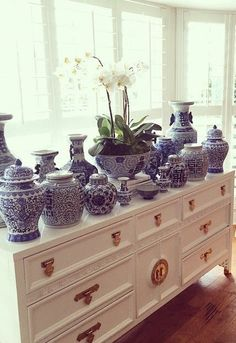 White dresser with gold chinoiserie handles, covered in blue & white vases and jars