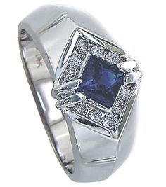 This+gorgeous+men's+ring+has+0.35Ct.+Square+Cut+blue+sapphire+set+with+Basel+in+the+center.+The+diamonds+are+channel+set+which+weigh+0.25cttw.+total,+H/+VS+2+color+and+clarity.+The+ring+width+is+10+mm+at+the+top+and+7+mm+at+the+bottom.+  The+ring+is+made+out+of+14+K+white+and+weighs+14+Grams.+A...