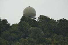Rua-O-Te-Whenua, located a little north of the TV mast in the Waitakere Ranges. The metal dome contains a secondary surveillance radar (SSR) antenna. This is one of six spread throughout NZ to give Air Traffic Control the position and height of any aircraft within a range of 463km. The Ruaotewhenua peak, at 440m is one of the highest points in the Waitakere Ranges. It also houses VHF radio equipment. Ruaotuwhenua map http://www.topomap.co.nz/NZTopoMap/nz5579/Ruaotuwhenua/Auckland
