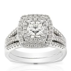 Ikuma Canadian Diamond two-piece double-halo wedding set with 1/2 carat cushion-cut center diamond and 91 non-Ikuma diamonds equaling 1/2 carat additional total weight. This bridal set is in 14K white gold. <b>All Ikuma diamonds originate from North America and are mined in Canada.</b> American Gem Society (AGS) documentation provided on center Ikuma diamond.