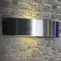 Riga by Fontana Arte: Dual light emission, aluminum wall mount, with an opaline diffuser. Available in nickel plate or stainless steel. Suitable for wet location.  www.illuminc.com Outdoor Wall Sconce, Outdoor Walls, Outdoor Living, Wall Fixtures, Wall Sconces, Dental Office Design, Opaline, Sconce Lighting, Diffuser