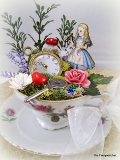 Alice in Wonderlands Tea Cup Garden Cake Topper, Storycup, Centerpiece. $65.00, via Etsy.