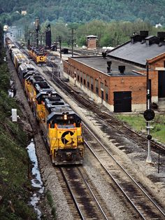 B&O, Rowlesburg, West Virginia, 1984 Eastbound Baltimore and Ohio Railroad freight train passing the shops at M&K Junction in Rowlesburg, West Virginia, on May 22, 1984. Photograph by John F. Bjorklund, © 2015, Center for Railroad Photography and Art. Bjorklund-17-03-01