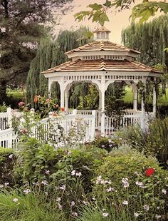 Want to build or decorate a backyard gazebo but you're low on inspiration? Read our article for amazing outdoor gazebo ideas that'll transform your garden! Outdoor Gazebos, Backyard Gazebo, Backyard Landscaping, Pergola, Outdoor Structures, Landscaping Ideas, Enclosed Gazebo, Victorian Gardens, Greenhouse Gardening