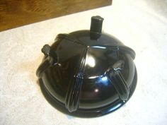 """Black Amethyst Glass Scrying/Gazing Bowl   If you shine a very bright light through it or hold it up to a sunny window, you can see a dark purple color around the edges. The center is thick enough that the light does not penetrate it. Very rare and unique piece.  This antique fruit/candy bowl is in good vintage condition and measures 6 3/4"""" across by 3"""" tall. There is a shallow chip on the bottom of one of the feet. 65,00"""