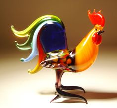 glass roosters are beautiful I have several, got them at Cracker Barrel they have cool roosters