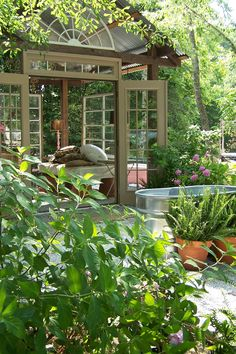 Plantings and flowerings in feed/water containers (butler).  Green house gazebo...