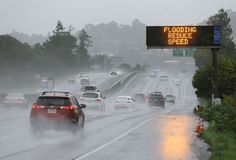 California storms:    A sign warns motorists of flooding on northbound Highway 101 on Feb. 20, 2017, in Corte Madera, Calif. Heavy downpours are swelling creeks and rivers and bringing threats of flooding in California's already soggy northern and central regions. The National Weather Service map shows floods, snow and wind advisories for the northern part of the state.