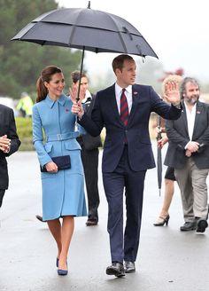 April 10, 2014: Duke and Duchess of Cambridge visit the Blenheim War Memorial in New Zealand. Kate is wearing a custom cornflower-blue Alexander McQueen coat, a poppy pin, Alexander McQueen shoes and carrying a clutch by Stuart Weitzman.