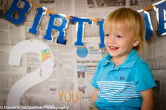 Baby Boy Photos, Photo Shoot Idea, DIY, newspaper backdrop, second birthday photo ideas, toddler, terrible 2's, baby photography, Danielle Jacqueline Photography, Blue Quicksilver Shirt, Boy Birthday Banner, baby boy photography props