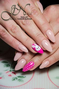 Nude stiletto nails, white rabbit, dotts