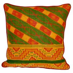 A vibrant plush pillow can invigorate an old couch or make a room sizzle with instant style. This Filling Spaces cushion has the requisite pop of color—and an extra helping of artisan-crafted character. Handmade in India from vintage sari fabric with beautiful embroidered detail, this one-of-a-kind accent will instill your living space with an upbeat bohemian vibe.