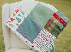 Handmade Christmas Patchwork Quilt by VntgPatchworkQuilts. Cozy Holiday Quilt. This quilt is exactly what your home needs this season to make life more festive and cozy. These adorable patterns and colors coordinate perfectly- little red Christmas flowers and different plaid fabrics will have you eagerly looking forward to the Christmas season just so you can pull out this quilt. Christmas Patchwork bedspread to decorate sofa, armchair, bed, and baby room.