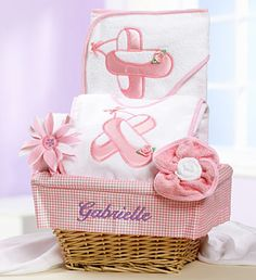 New Baby Girl Ballet Dancer Gift Basket- real wicker lined gift basket with embroidered baby's name, hooded terry cloth bath towel and terry cloth bib with ballet slipper embroidery, terry cloth washcloths rolled to look like a flower and a super cute infant flower headband $89.99 #babygirl #ballet