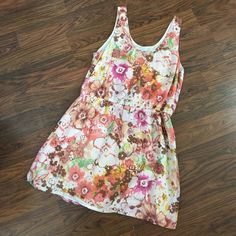 J. Crew watercolor floral sleeveless dress size 12 Adorable J. Crew dress. Pinks, Browns, greens, white/creams, yellows, coral watercolor print. Worn once for an hour. Size 12 J. Crew Dresses Midi