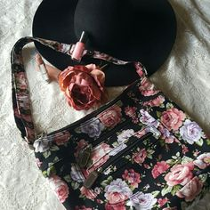 Crossbody Floral Purse Absolutely Adorable Floral Crossbody purse, brand new without tag. It has a total of 3 zippers, one on the top and two on the front pockets with leather zipper detail.  Bundles welcome great discounts  Please reasonable offers only  ♡Thank you for shopping my closet♡ Bags Crossbody Bags