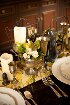 Great ideas for using vintage silver on wedding tables...web site for more images....http://www.elizabethannedesigns.com/blog/2010/10/04/elegant-french-inspired-wedding-table/