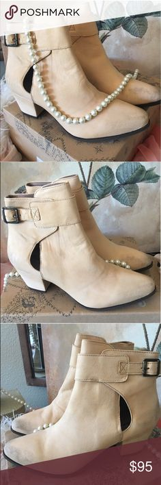 """🎀🆕Free People Belleville Booties New in Box🎀 These are another example of the distressed look booties and all marks on them are exactly as they came and should be. New in box!! A chunky wrapped heel and a keyhole cutout lend modern appeal to a chic ankle bootie shaped from rich leather or supple suede. 2"""" heel (size 39). 4 1/2"""" bootie shaft; 2"""" heel height. Leather or suede upper/leather lining/synthetic sole. Adjustable buckle-strap closure. By Free People; made in Portugal. Free People…"""