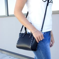 Leather bag with studs? Yes please!  This size is perfect! Check the link and shop now: marcez.com/product/black-studded-handbag/