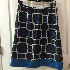 """Talbots silk skirt Talbots chocolate/cream/deep turquoise silk skirt w/side zipper, deep turquoise hem. Fully lined. Size 4. Approx measurements flat: length 23.5"""", waist 14.75-15"""" (has slight curve so hard to be exact). 100% silk, lining 100% polyester. Please ask any questions prior to purchasing. Thank you! Talbots Skirts"""