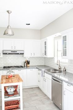 Take inspiration from this complete kitchen renovation with ideas from this homeowner. White subway tiles and cabinets, a movable island, and stainless steel appliances keep this modern space feeling light and airy.