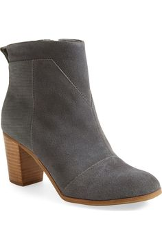 A grid-embossed back panel and sleek, angular seams bring modern, architectural style to this standby ankle bootie from the Nordstrom Anniversary Sale.