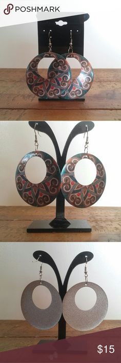 Printed Multicolor Metal Cutout Circle Earrings Beautiful pair of earrings, light silvertone metal (aluminum?) with a multicolored pattern printed overtop. Great condition with just some light scratching that blends in with the pattern (the worst is shown in the last pic). Earrings look oval in pictures, but are actually perfect circles, 2 inches across.  Free gift wrapping on request. Jewelry Earrings