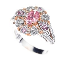 The Peony Pink #Argyle diamond is the life of the party as she sits proudly in the centre of her Argyle diamond friends. The filigree under-basket and milgrained edging is a perfect venue for this sparkly soiree of pink and white diamonds in rose and white gold. With more than one carat of stones this stunning piece is valued at approximately $500,000! Nina's #WesternAustralia