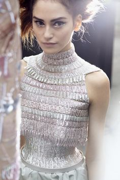 Chanel. I like this silhouette.