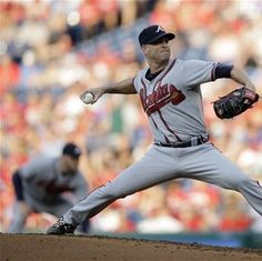 Tim Hudson pitches in the first inning against the Philadelphia Phillies