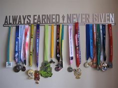 Ideas+For+How+To+Display+Your+Running+Race+Bibs+And+Medals Fitness room ideas Trophy Display, Award Display, Trophy Shelf, Ribbon Display, Ribbon Storage, Running Race, Running Medals, Running Club, Running Gifts