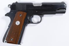 Lot 281: Colt Combat Commander .45 Cal. Semi-automatic Pistol (Serial #70BS30962); Mfg 1975, magazine fed semi-automatic pistol, blued steel with wooden grips. Includes leather holster