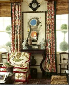 On the windows, toss out metal and wooden blinds. Instead, choose textured bamboo blinds or fabric shades. Be sure to hang the blinds as high to the crown molding as possible to elongate the line. Use ethnic prints for curtains over the blinds. Ikat Curtains, Blinds Curtains, Burlap Curtains, Window Blinds, Room Window, Hanging Curtains, Window Seats, Window Panels, Window Coverings