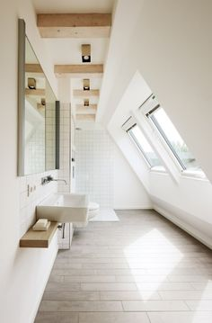 Check Out 43 Useful Attic Bathroom Design Ideas. Attic spaces are considered to be difficult to decorate due to the roofs of various shapes. Loft Bathroom, Bathroom Interior, Modern Bathroom, White Bathroom, Narrow Bathroom, Washroom, Neutral Bathroom, Skylight Bathroom, Small Attic Bathroom