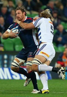 Scott Higginbotham Photos - Scott Higginbotham of the Rebels is tackled by Andries Bekker of the Stormers during the round 14 Super Rugby match between the Rebels and the Stormers at AAMI Park on May 2013 in Melbourne, Australia. - Rebels v Stormers Super Rugby, Melbourne Australia, Rebel, Running, Park, Fashion, Moda, Fashion Styles, Keep Running