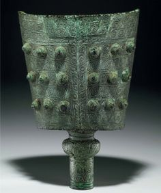 VERY RARE AND IMPORTANT LARGE BRONZE RITUAL BELL, NAO LATE SHANGEARLY WESTERN ZHOU DYNASTY, 11TH-10TH CENTURY BC, 18¼ in. (46.4 cm.)