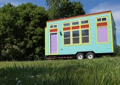 180 Sq. Ft. Yosemite Tiny House on Wheels with bright aqua and purple exterior ~ surprisingly spacious inside. | Tiny Homes