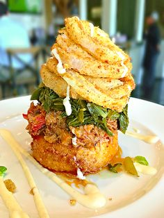 This Pulled Pork Stack from The Front Porch at Ross Bridge in Birmingham, AL is ridiculous. Fried Smoked Gouda Grit Cake topped with Pulled Pork, Turnip Greens, Onion Rings and White BBQ Sauce. Bbq Pork, Pulled Pork, Grit Cakes, White Bbq Sauce, Turnip Greens, Smoked Gouda, Brunch Spots, Cake Toppings, Onion Rings