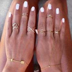 Create the perfect mix of boho and edge with the Double Ring & Chain Bracelet. Featuring an adjustable lobster clasp, layer this 14K plated piece with other mixed metal rings and delicate bracelets, o #goldrings
