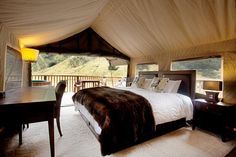 Visit Seasonz Travel for luxury camping in New Zealand including Safari Camp at Poronui, Taupo and Minaret Station, Wanaka.