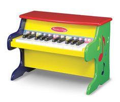 """Learn-to-Play Piano: This colorful upright piano features 25 keys and two full octaves. The littlest musicians will enjoy exploring concepts of high and low notes, loud and soft. More experienced """"maestros"""" can follow the color-coded songbook to learn nine child-friendly favorites! *This classic toy continues to be a favorite..."""