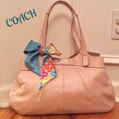 """Coach Lexi Leather Shoulder Bag Sweet!!!  Buttery soft leather. Coach Lexi is a very functional bag!!!  The color is a Metallic Light Pearl Pink. Dual double rolled shoulder straps w/ 9"""" drop. Nickel hardware, hang tag, 3 compartments 2 w/ magnetic snap and center is a zip. Interior is very spacious, with a zip pocket, large slip pocket, and 2 more slips pockets. Gray Sateen fabric. 2 very small and light marks on interior side, 4th pic. The bottom of 1 compartment has a few small specks…"""