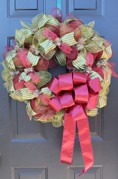 Deco Mesh Wreath with Beautiful Moss Green and Burgundy Mesh with Green-Striped Ribbon and Burgundy Ribbon and Bow. Find more at www.facebook.com/southernhomewreathsandart