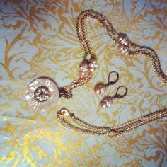 Vintage 40's buttons, fresh water pearls and antique crystals. D. Wallace Designs