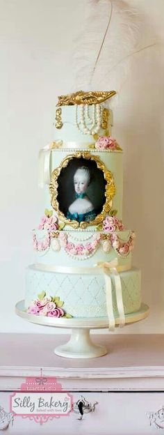 I love the two bottom tiers...Marie Antoinette using gum paste molds from Sugar Art Molds