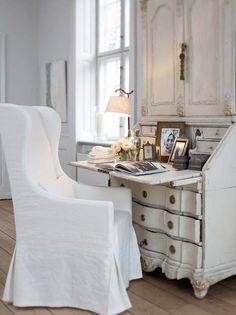 Slettvoll: Chic bedroom with gray French secretaire cabinet with brass trim paired with white ...